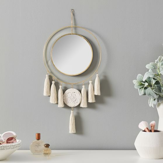 Metal And Mirror Wall Decor from assets.ptimgs.com